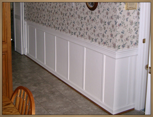 Wainscoting after decorative wall panels installed