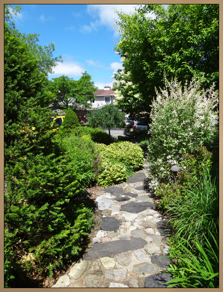 Custom Landscaping Rock Path and Garden Photo