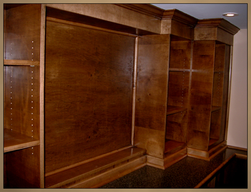Photo of solid maple wood moulding including crown moulding, baseboards, quarter round and various custom made pieces.